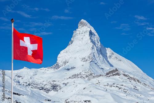 Poster Famous Matterhorn with flag of switzerland