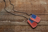 USA dog tags on wooden background - 111729690