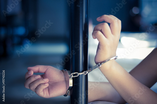 Poster Lady with handcuff on bed, Human trafficking - Concept Photo