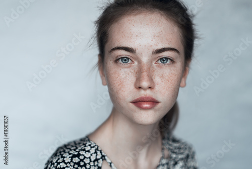 beautiful young girl with freckles close-up