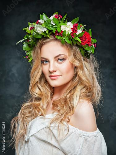 beautiful blonde girl in a wreath of flowers