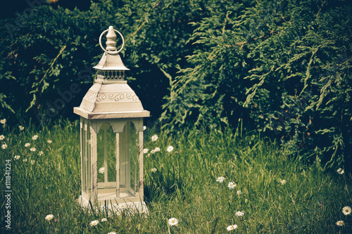Poster lantern on grass in vintage style
