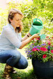 Portrait of beautiful 40 years old woman gardening on sunny day