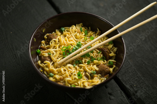 Asian quick noodles on wood background photo Poster