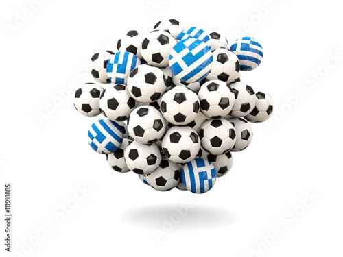 Zdjęcia na płótnie, fototapety, obrazy : Pile of footballs with flag of greece