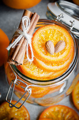 Candied oranges in glass jar, top view