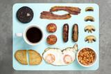 English Breakfast on blue chopping board
