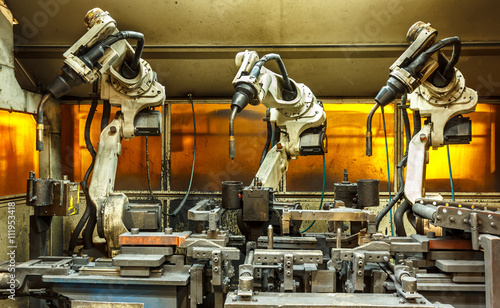 Robots welding team in the automotive parts industry