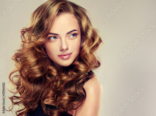 Beautiful girl with long wavy hair Poster
