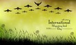 Field of grass and flying birds on bokeh background