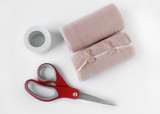 Medical bandage rolls, bandage, elastic , scotch tape, first aid supplies, a white background.