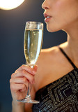 close up of woman drinking champagne at party