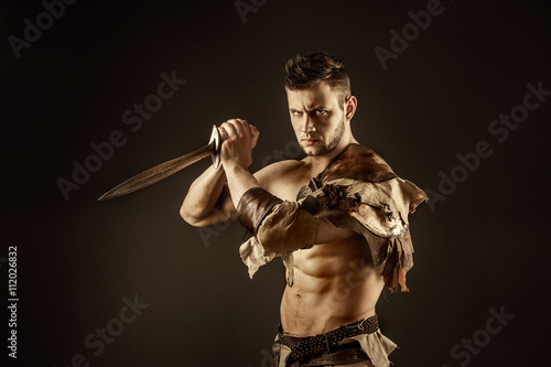 Poster Portrait of handsome muscular gladiator with sword
