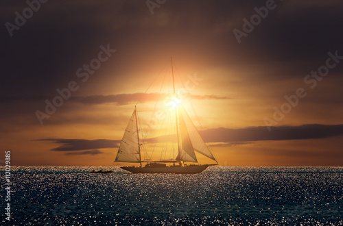 Fotobehang Zeilen Yacht sailing in Mediterranean during sunset
