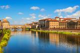 Florence, Ponte Vecchio bridge over river Arno and Palazzo Vecchio (Tuscany, Italy) - 112045071