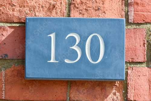 Poster House Number 130 sign