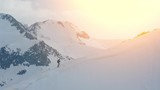 Drone Footage Man Climbing Snowcapped Mountain Adventure Alps Majestic Courage Exploration Hiking Vacation Snow Tranquility Nature Travel Recreation White Cold Aerial Agility Mountaineering