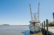 Shrimp boat tied to pier