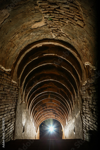 In de dag tunnel background and business concept. tunnel with old brick. the end of tunnel and concept business successfully. mystery tunnel or mystery way. tunnel damaged and waited for repair.