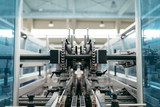 Robotic factory line for packaging of bottled pure spring water. Selective focus. Short depth of field. - 112194037