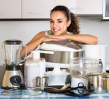 Housewife with multicooker and appliances