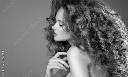 Beautiful Woman with Curly Long Hair. High quality image. © svitlychnaja