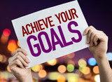 Achieve Your Goals placard with night lights on background