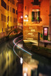 Narrow canal in Venice at night