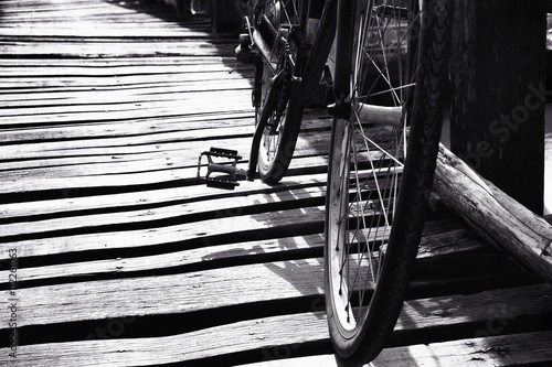 Poster Black and white a bicycle on the wooden bridge