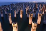 Mooring poles at night at Princes Pier