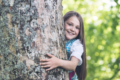 Smiling Girl and a big old Tree Poster