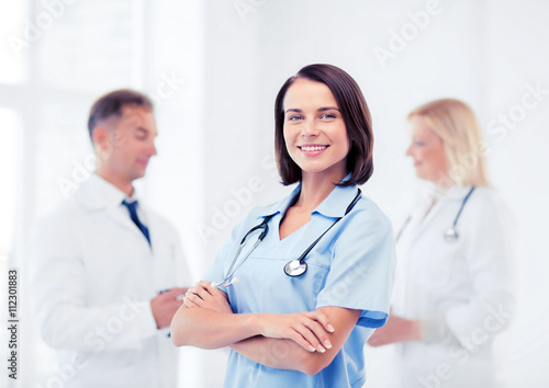 young female doctor with stethoscope Plakat