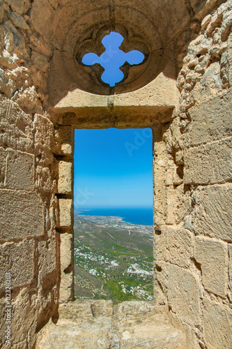 Fototapeta City view through the window of an ancient fortress, Cyprus