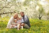Fototapety Happy Family of Five Portrait in Spring Flower Meadow