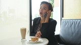 Asian business woman working and discussion with mobile phone in coffee shop