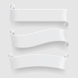Three white ribbons with drop shadow on white background