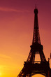 Eiffel Tower silhouette at sunset in Paris France
