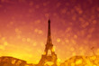 Eiffel Tower silhouette at evening sunset light in Paris France with shiny golden glitter double exposure effect