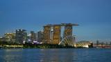 Panning shot of Singapore after sunset.