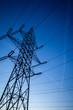 High voltage pylons on blue sky