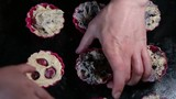 Cooking muffins. Hands moving silicone baking forms