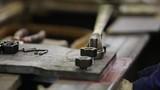 Worker tightening the screws
