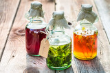 Bottles with honey, linden, mint and alcohol as natural medicine - 112455049