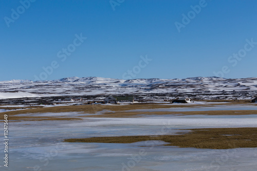Poster Winter natural landscape with mountain background and clear blue sky, Iceland