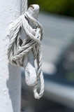 Halyard tied off to cleat on flagpole