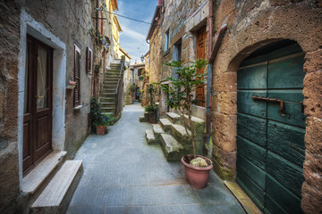 Spring streets of the old Tuscan town. Colorful flowers bloom