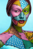 Girl with colorful body art on face and body