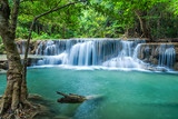 Fototapety Green landscape with green waterfall at Erawan waterfall , Beauitful and very nice waterfall for relaxation, Erawan waterfall loacated Kanjanaburi Province , Thailand