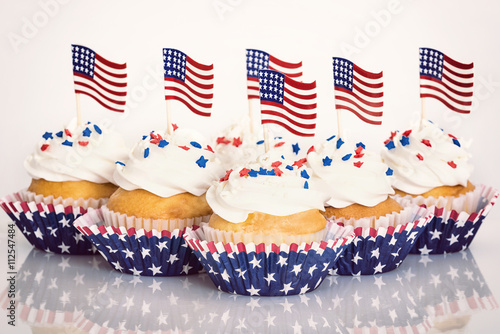 f0b2f8e37ae Patriotic cupcakes with sprinkles and American flags