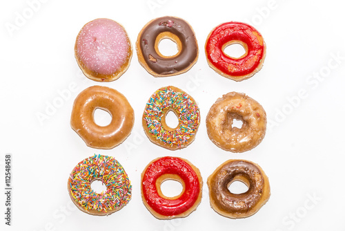 Poster Colorful glazed donuts collection isolated on white background, top view